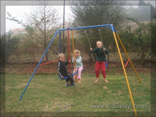 KidZplay Preschool swing with wooden seat.