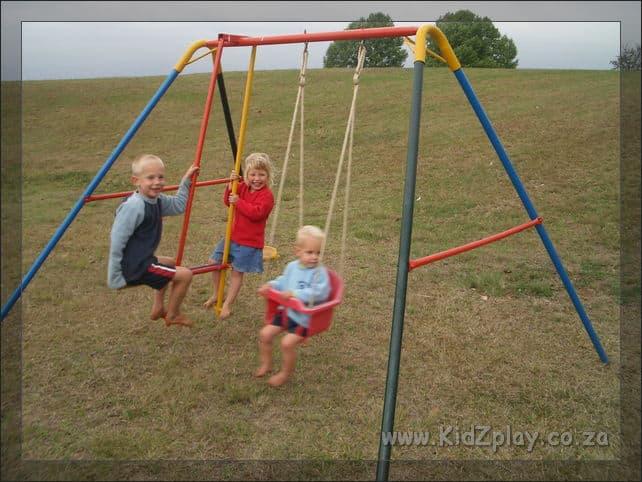 KidZplay Preschool swing with plastic seat.